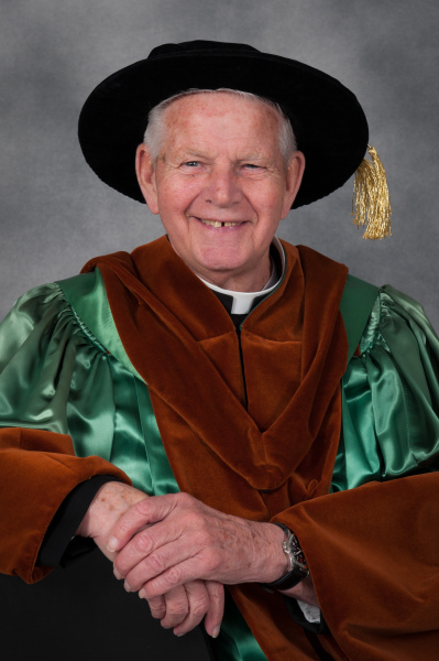 Photo of Fr. Charlie in his honorary doctorate regalia at Convocation 2015