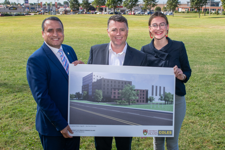 Photo of President, Premier, and Student Union President at site of new residence