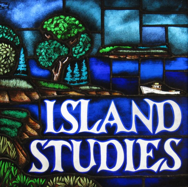 "A stained glass image of a coastal shoreline with beaches, trees, and farmland with the title ""ISLAND STUDIES"" in white"
