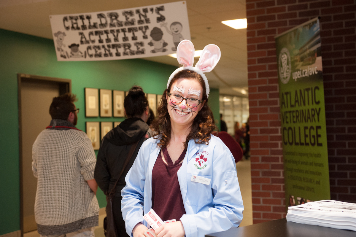veterinary student with her face painted like a rabbit