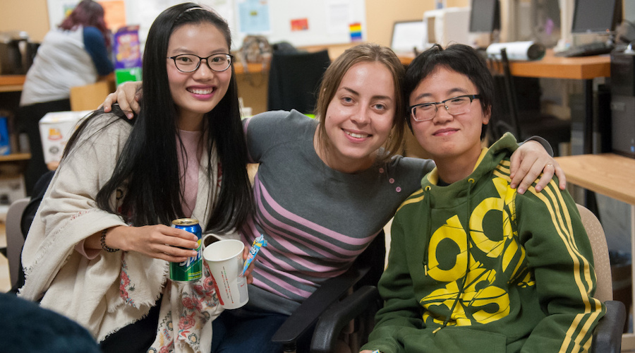 upei student han xu and two friends in the upei student life lounge