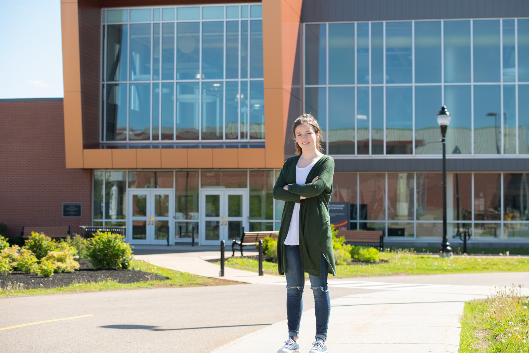 upei student sydney wheatley in front of the sustainable design engineering building
