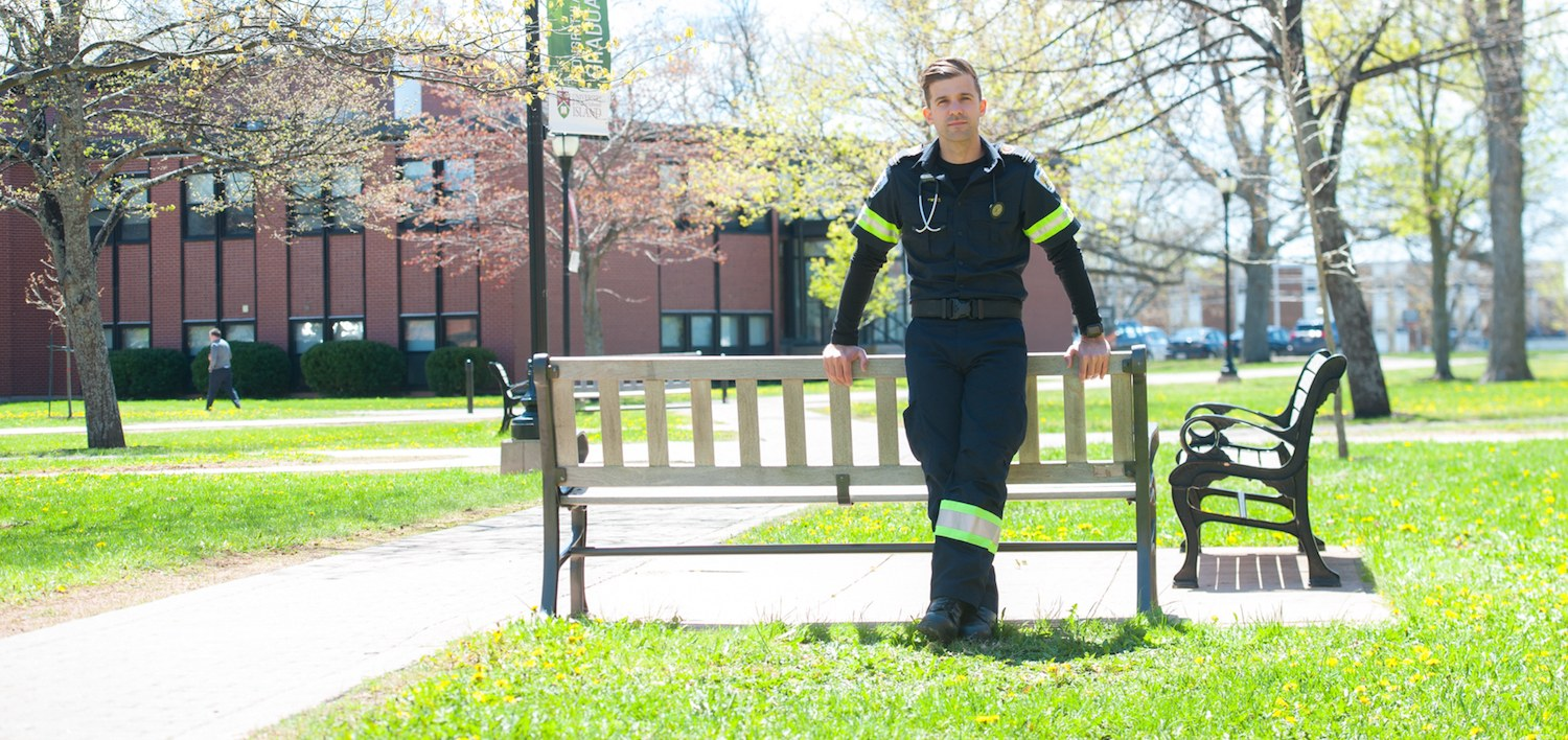male paramedic standing in the UPEI quad