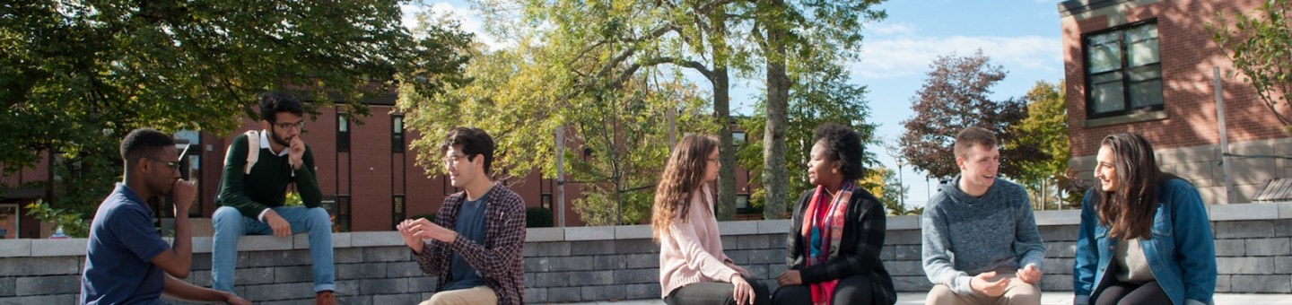 students sitting in the outdoor amphitheatre
