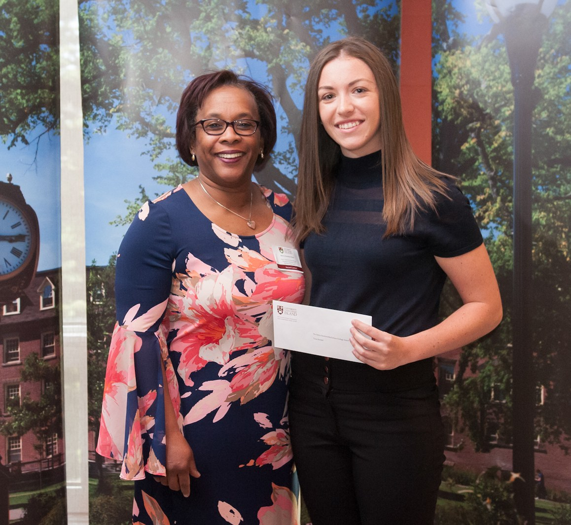 professor presenting a cheque to a student