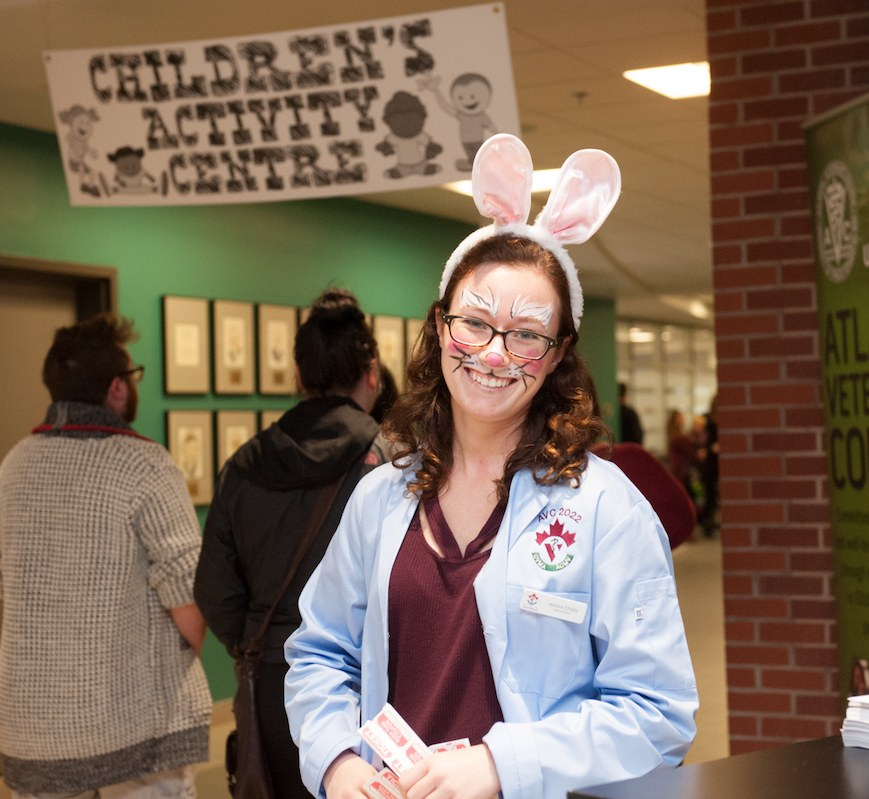a veterinary student with her face painted like a rabbit
