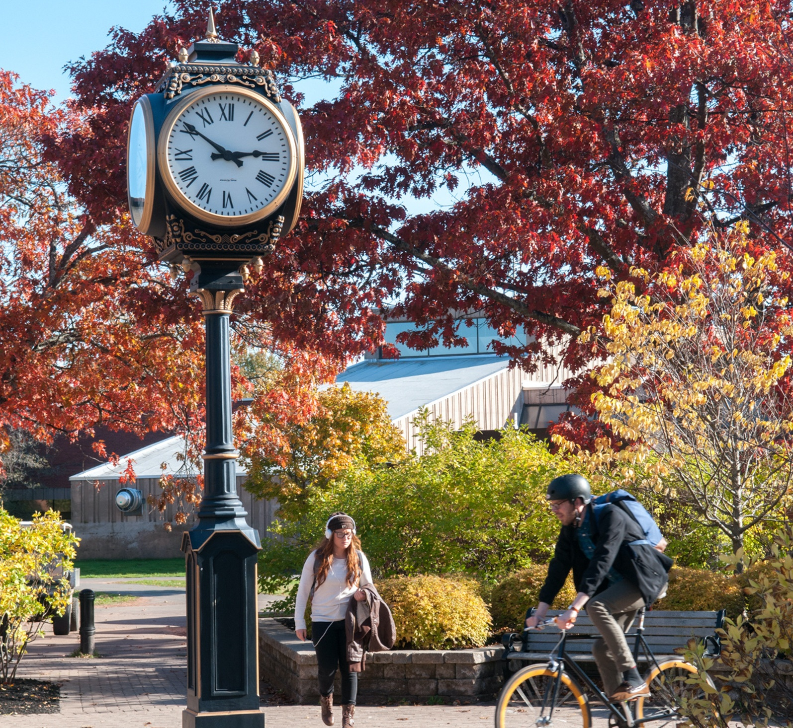 Students pass under the UPEI clock