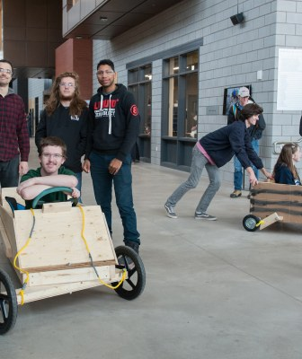 upei engineering students pose with a gravitational car