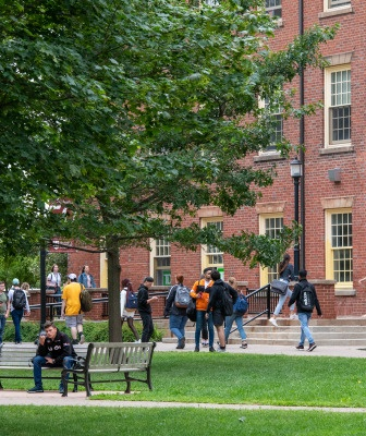 students walk across UPEI campus