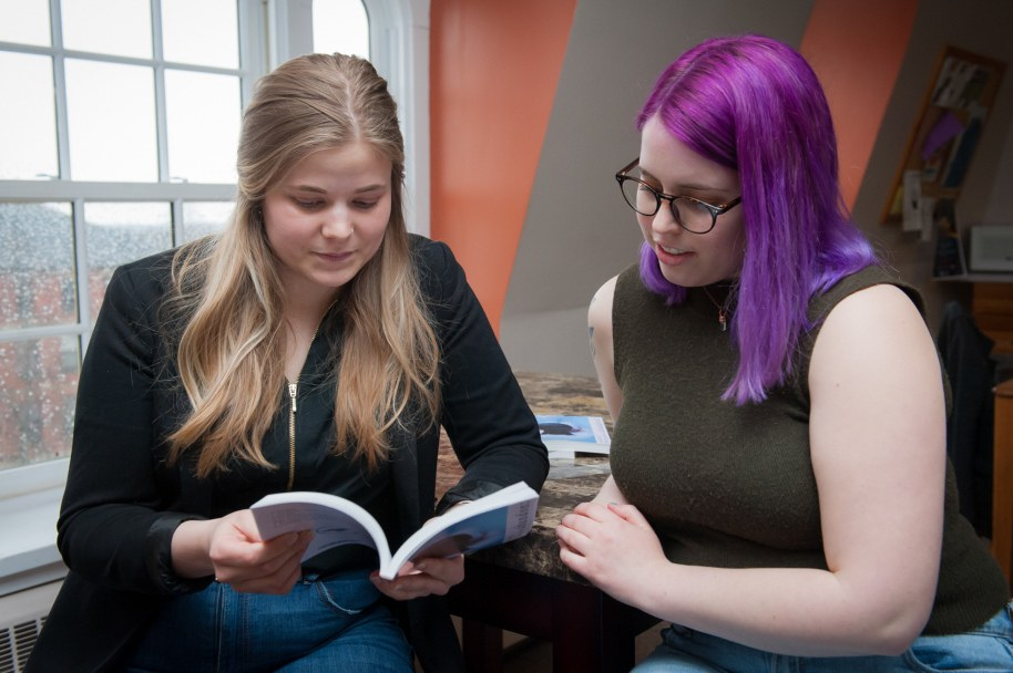 Students read a copy of the UPEI Arts Review