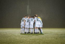 Soccer players huddle