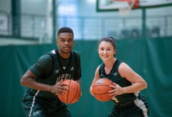 A male and a female basketball player