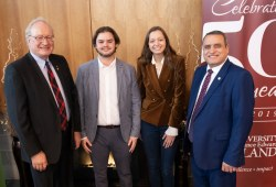 UPEI President Emeritus Wade MacLauchlan (left) and UPEI President and Vice-Chancellor Alaa Abd-El-Aziz (right) congratulate Tyler Power and Lorelei Kenny, two of the winners of 2019 MacLauchlan Prizes for Effective Writing, at a ceremony held in Don and Marion McDougall Hall last fall.