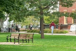 image of student wearing mask in the quadrangle