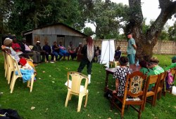 Farmers in Kenya participate in a training session.  Standing at right is Dr. John VanLeeuwen.