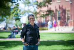 photo of professor Ann Braithwaite in UPEI's quadrangle on a summer day