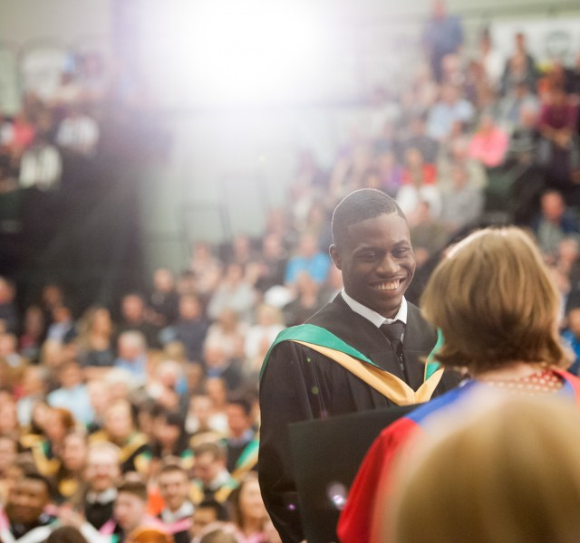 a graduate accepts his degree