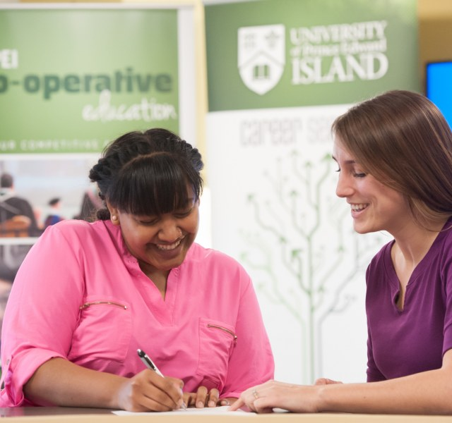 A student works with a career services staff member