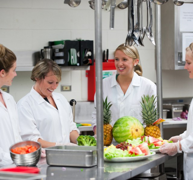 dietetic interns working in an industrial kitchen